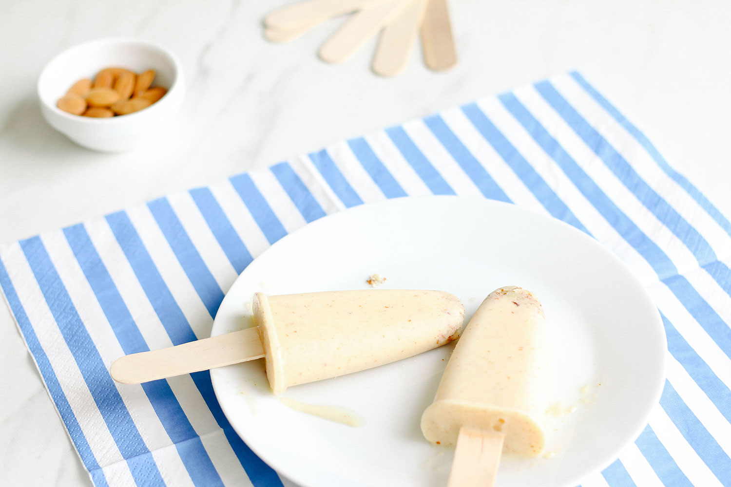 Yogurt Peach Pops Recipe: The perfect go-to snack for cooling off on a hot summer day. Only 100 calories each! https://www.spotebi.com/recipes/yogurt-peach-pops/
