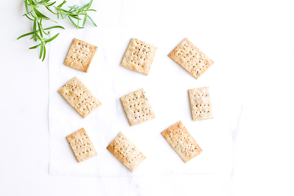 Rosemary Sesame Rice Crackers Recipe: Delicious crispy crackers as good as store-bought but made with a simple, feel-good list of ingredients. https://www.spotebi.com/recipes/rosemary-sesame-rice-crackers/