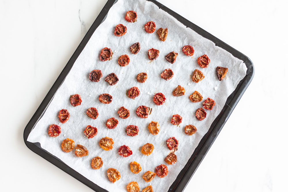 Oven-Dried Tomatoes Recipe: Intensely flavored and nutrient-packed to add depth and a summery taste to your salads, sandwiches, dressings and pasta dishes! https://www.spotebi.com/recipes/oven-dried-tomatoes/
