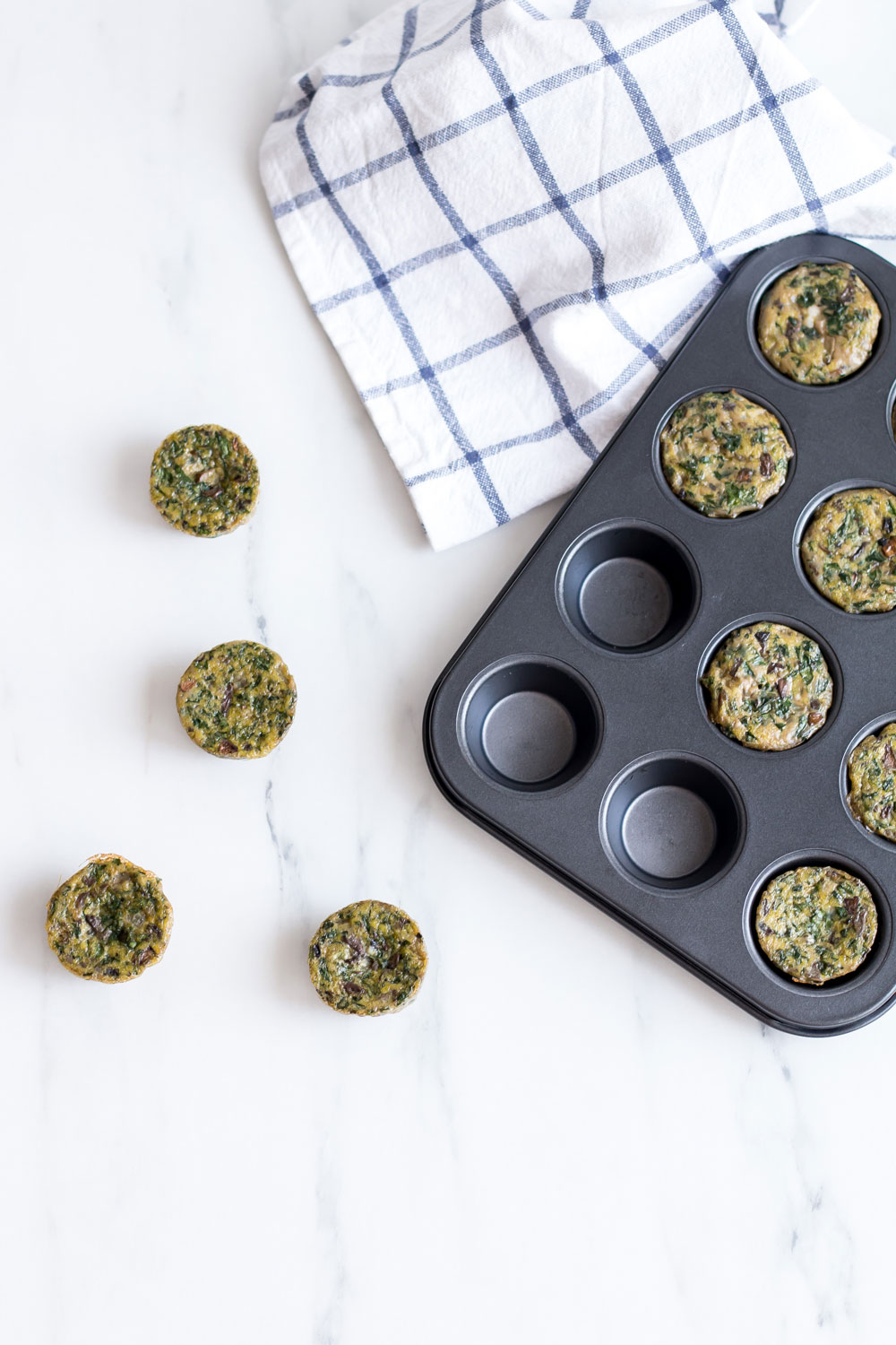 Clean Green Veggie Egg Muffins Recipe: Gluten-free, low-carb and only 35 calories each! https://www.spotebi.com/recipes/clean-green-veggie-egg-muffins/