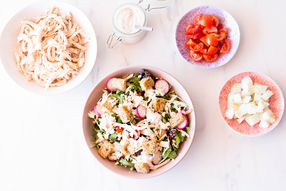 To keep it simple in the kitchen, you can pick up a rotisserie chicken on your way home and make a healthy salad like this chicken Caesar salad with homemade croutons. Just mix shredded chicken with veggies, Parmesan cheese, homemade croutons and vegan cashew mayonnaise, scoop all into a salad bowl and dig in. https://www.spotebi.com/recipes/chicken-caesar-salad-homemade-croutons/