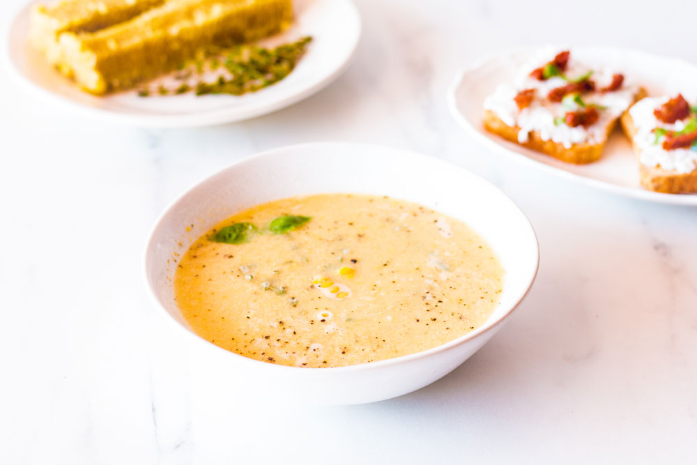 Corn on the cob season is almost over, and this Simple Corn Soup with Fresh Herbs is the perfect end of summer soup recipe! https://www.spotebi.com/recipes/simple-corn-soup-fresh-herbs/