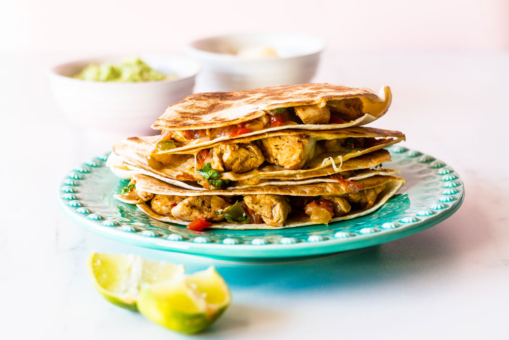 Quesadillas are a crowd favorite, and this easy chicken quesadilla recipe is a quick, filling, delicious meal that you can make for lunch, dinner, or breakfast in under 30 minutes. https://www.spotebi.com/recipes/easy-chicken-quesadilla-recipe/
