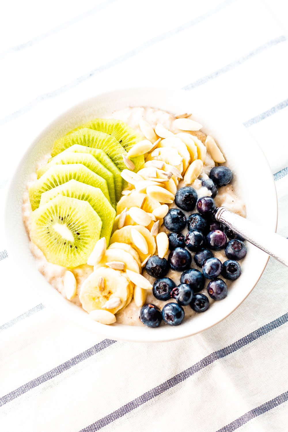 This Immunity-Boosting Oatmeal Breakfast Bowl is a healthy way to start your day, especially during flu season. It's filled with good for you ingredients that will help your body fight off viral infections and recover faster if you do get sick! https://www.spotebi.com/recipes/immunity-boosting-oatmeal-breakfast-bowl/
