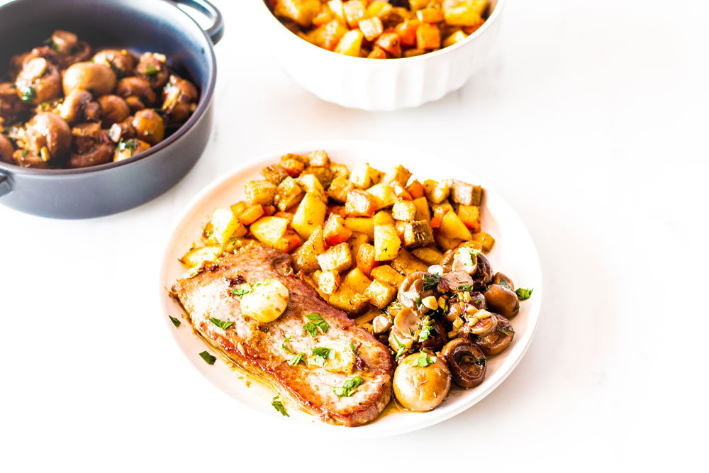 This Pan-Seared Steak with Garlic Mushrooms is a recipe that garlic lovers will want to get their hands on! The sauteed garlic mushrooms and the mouth-watering herb garlic butter sauce are mushroom heaven! https://www.spotebi.com/recipes/pan-seared-steak-garlic-mushrooms/