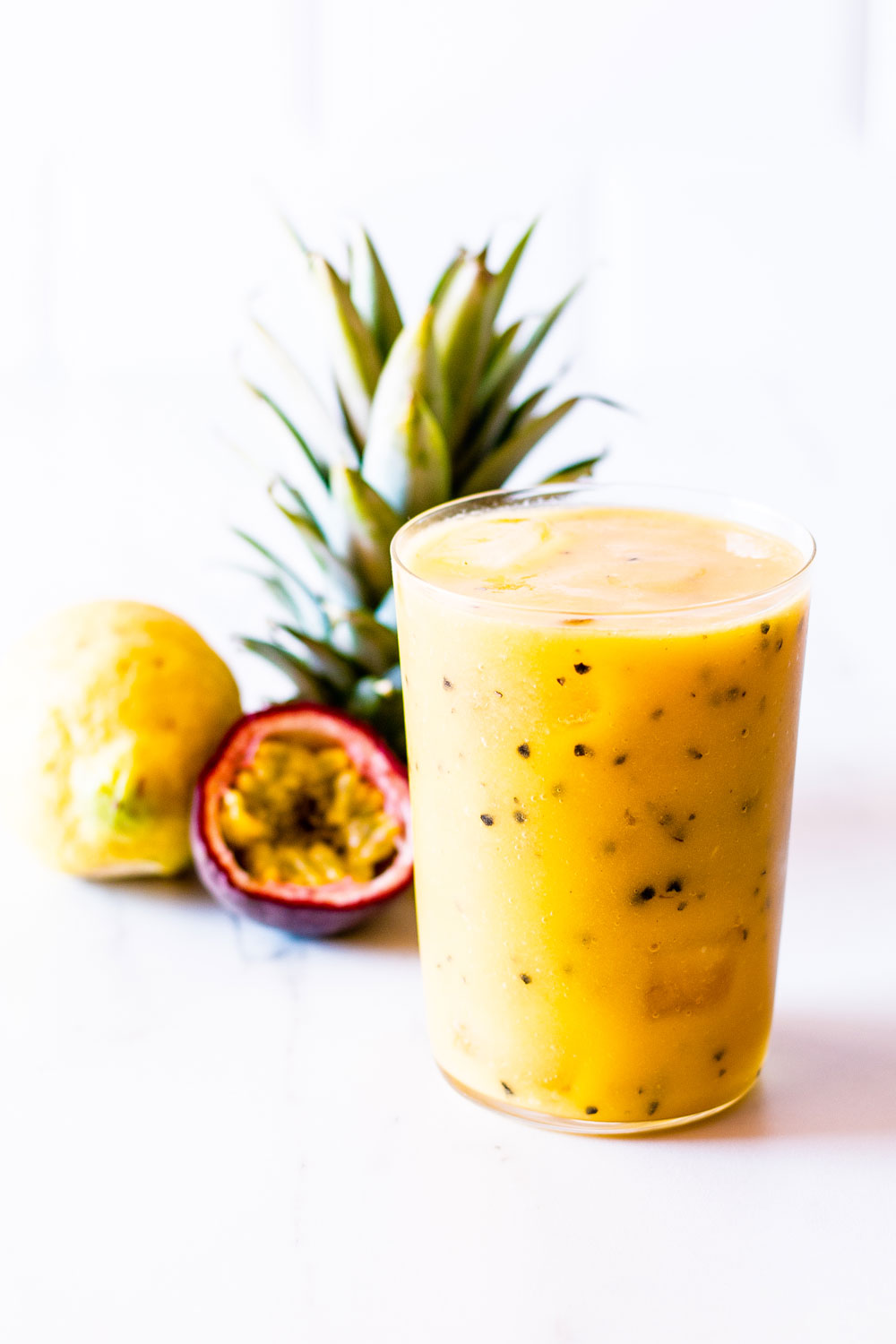 This passion fruit, mango & pineapple tropical smoothie is packed with vitamin C and helps keep your skin tight, glowy, and protected from the sun! https://www.spotebi.com/recipes/passion-fruit-mango-pineapple-tropical-smoothie/