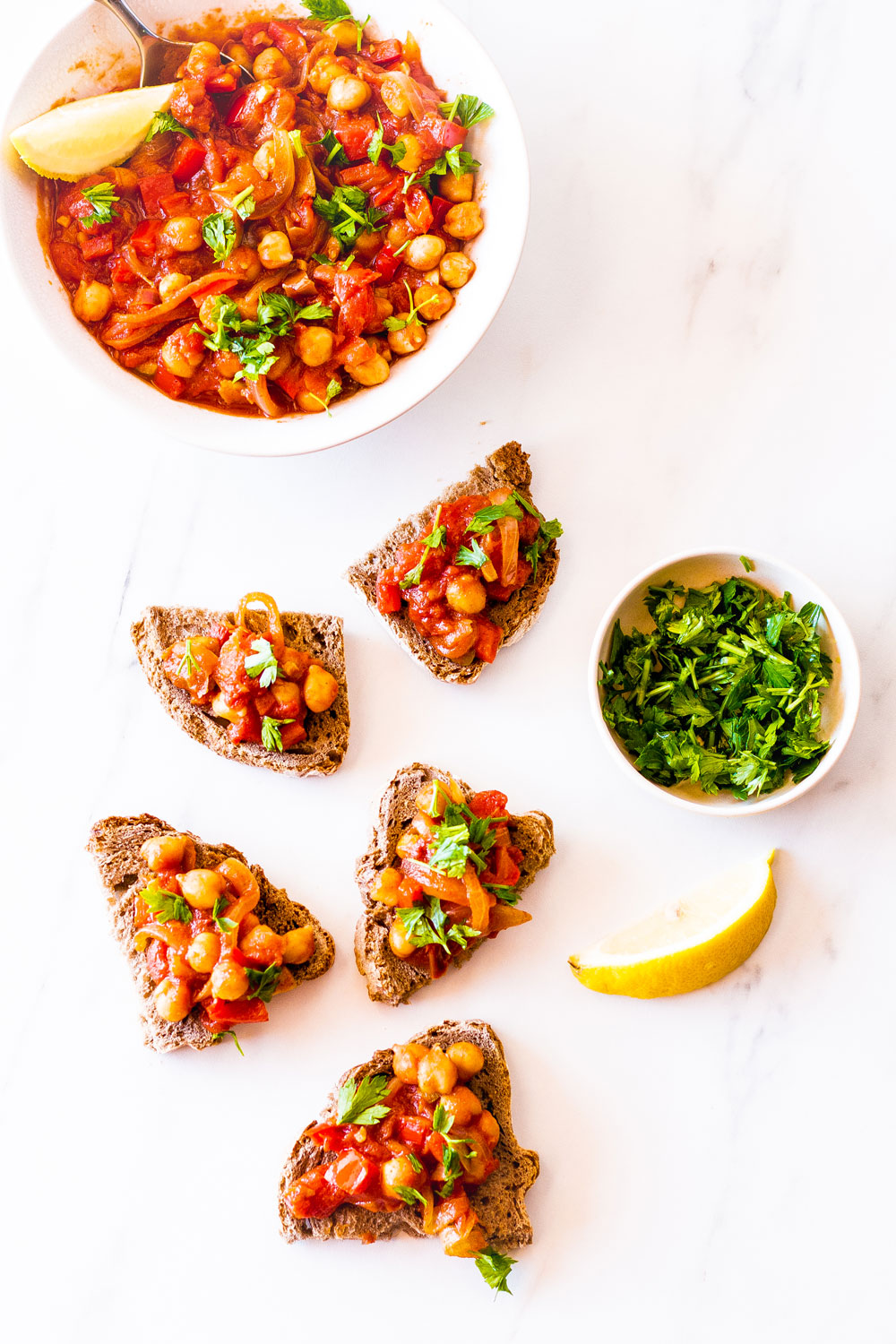 This Spicy Chickpea, Tomato & Bell Pepper Toast is a crunchier alternative to the quintessential hummus toast. It's tasty, comforting, easy to eat on the couch, and perfect to snack on! https://www.spotebi.com/recipes/spicy-chickpea-tomato-bell-pepper-toast/