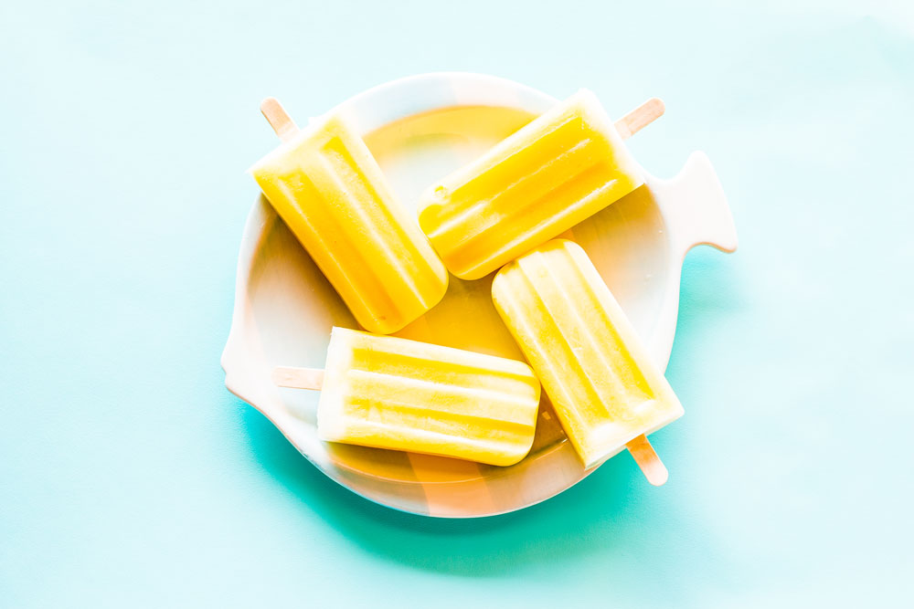 For this Healthy 3-Ingredient Orange & Mango Popsicles recipe, we mixed chunks of mango with blended orange juice, mango, and yogurt and topped each popsicle with plain velvety yogurt! https://www.spotebi.com/recipes/healthy-3-ingredient-orange-mango-popsicles/
