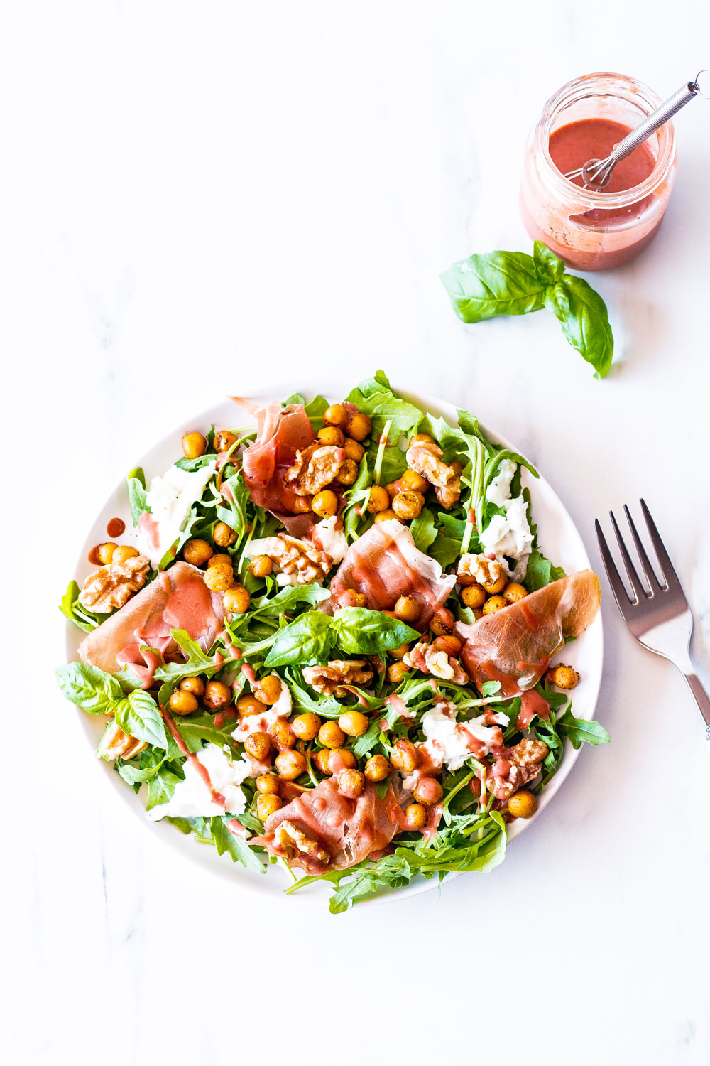 For a festive end-of-summer salad, try this prosciutto, mozzarella, and spicy chickpea salad with strawberry vinaigrette. This recipe is loaded with good quality Italian prosciutto and served with a fragrant sweet and sour salad dressing. https://www.spotebi.com/recipes/prosciutto-mozzarella-spicy-chickpea-salad-strawberry-vinaigrette/
